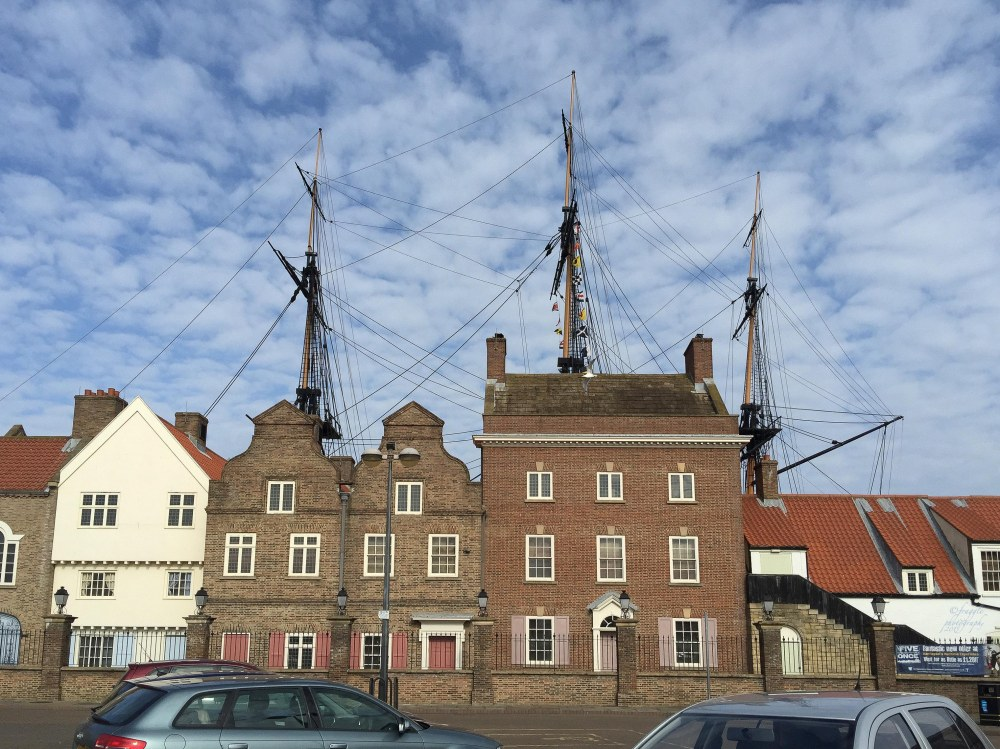 You can see the ships masts above the buildings in the carpark.